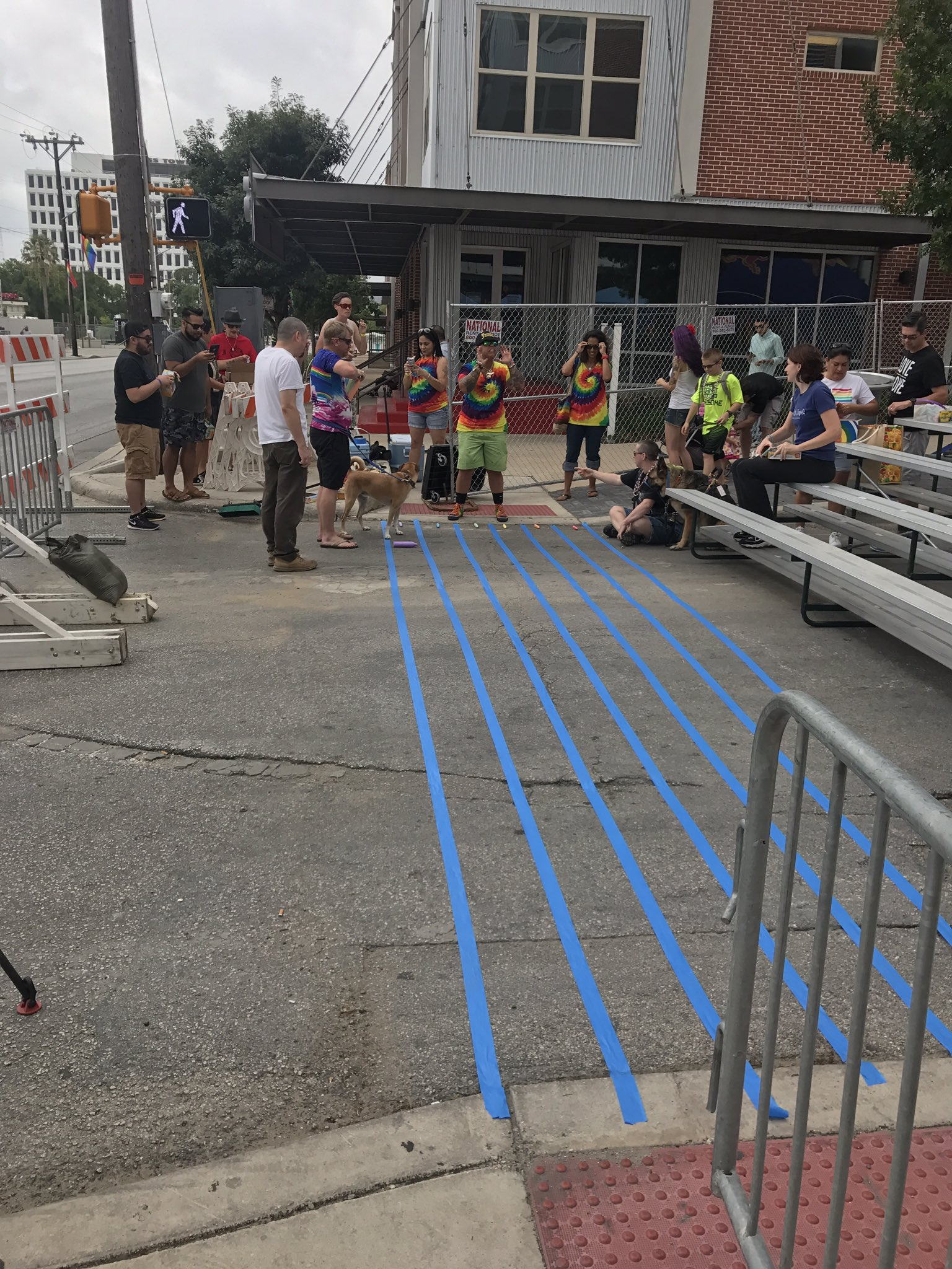 2 sides of intersection blocked off, w/  other two sides to be painted later. Volunteers splitting crosswalk into 6 colors of the 🌈 #PrideSA https://t.co/j114DPtbP0