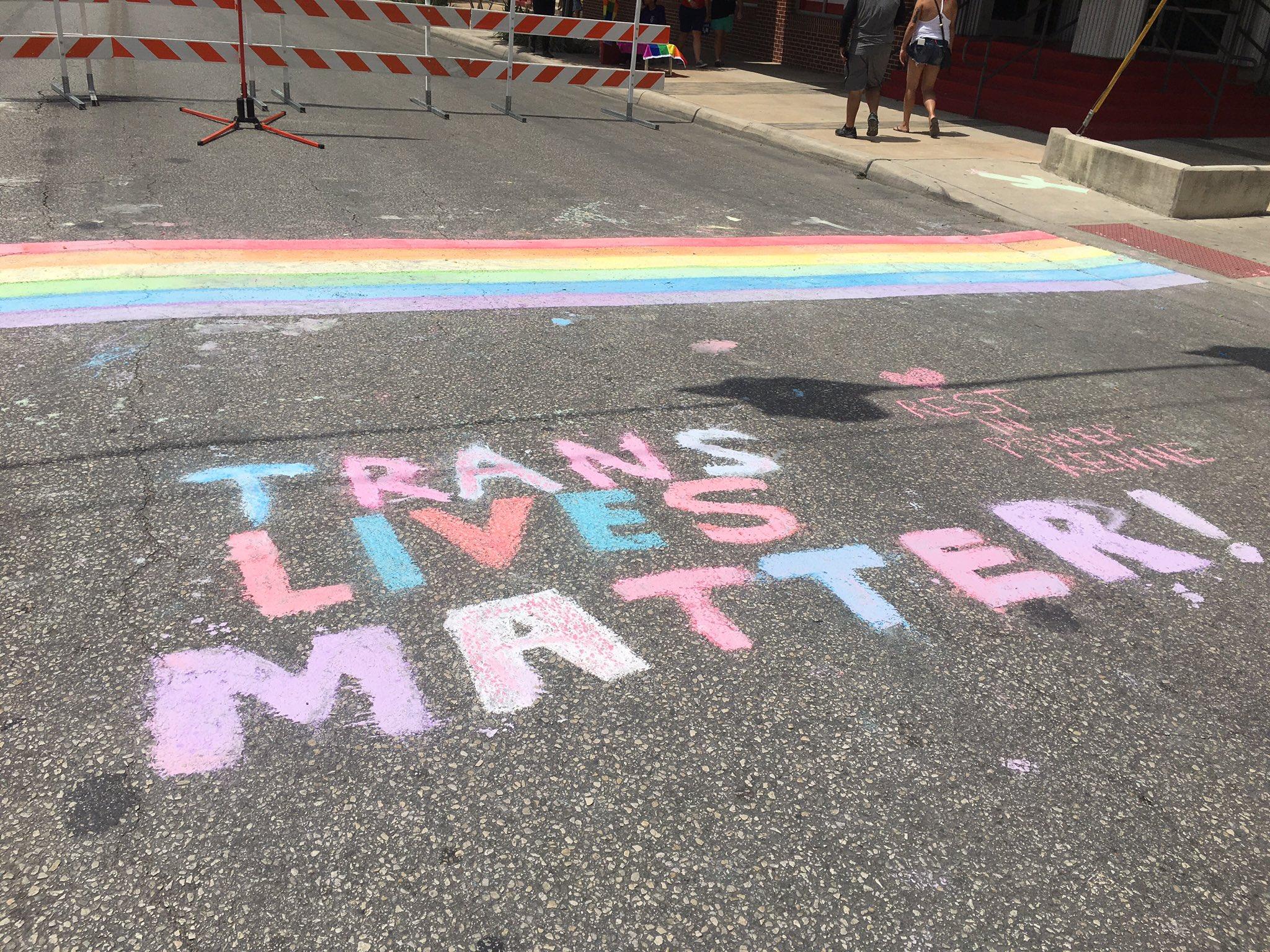 """Trans Lives Matter"" added below chalk rainbow crosswalk at Evergreen and N. Main ave. https://t.co/I5Z6NE7H56"