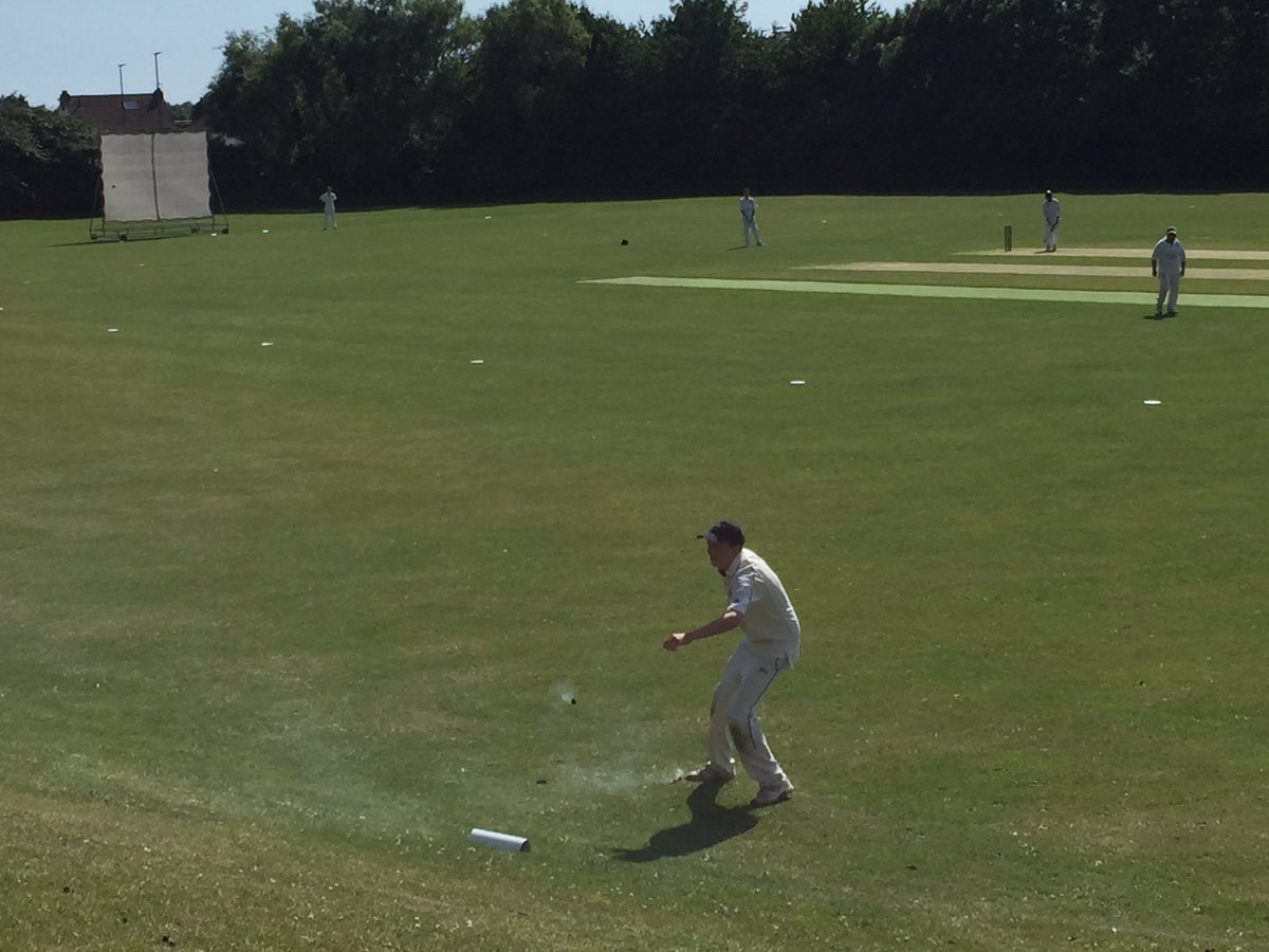 Game comes to a stop as smoke pellets have to be removed from the field of play @worthingcc #slade