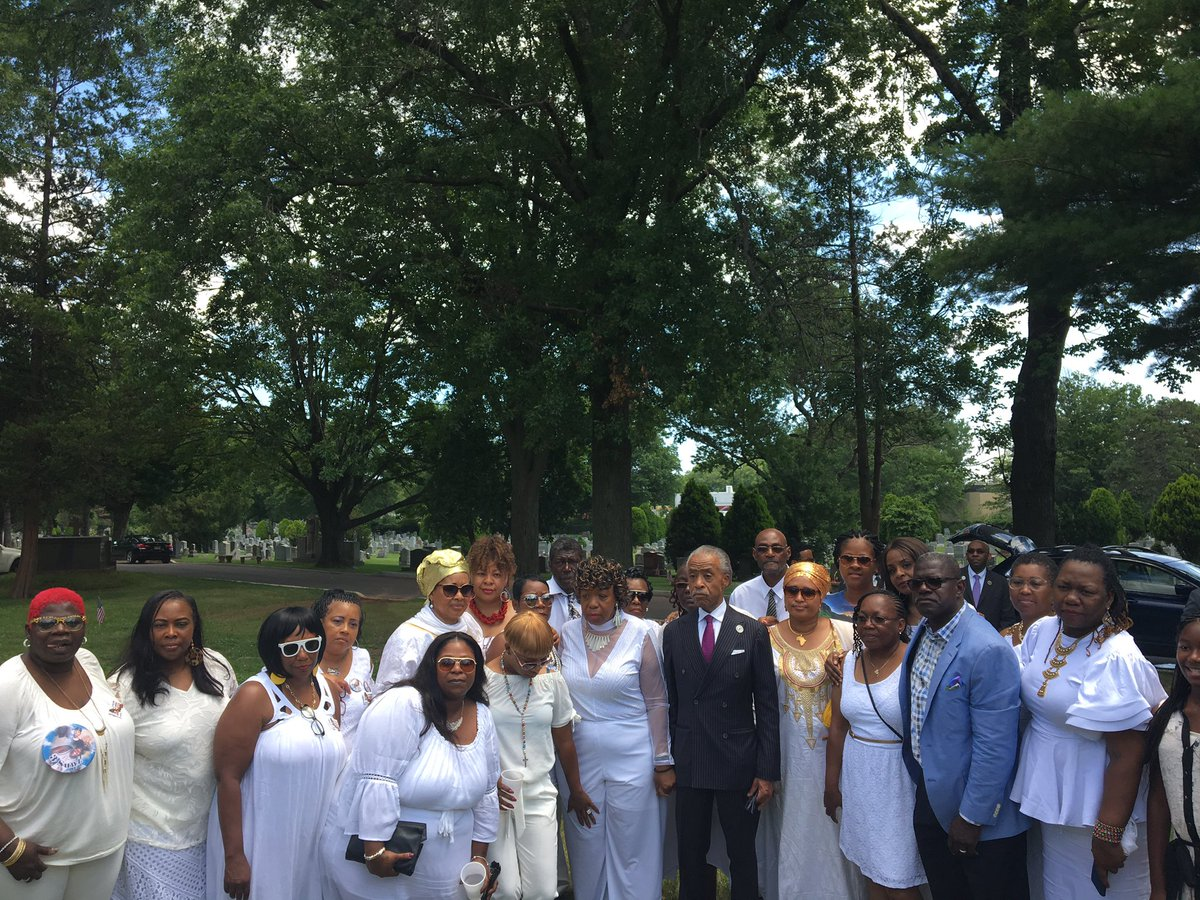At Eric Garner's grave supporting his mom Gwen w/Pastor Bartley & more mothers of victims of police brutality. Please keep them in prayer.