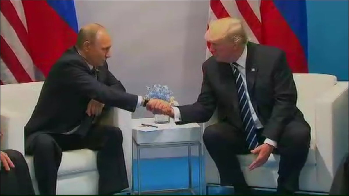 Trump and Putin shake hands at the G20 meeting
