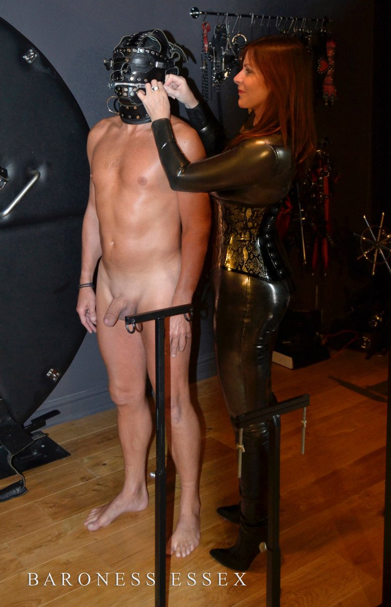image Beautiful mistress use 2 slaves for his ass and feet