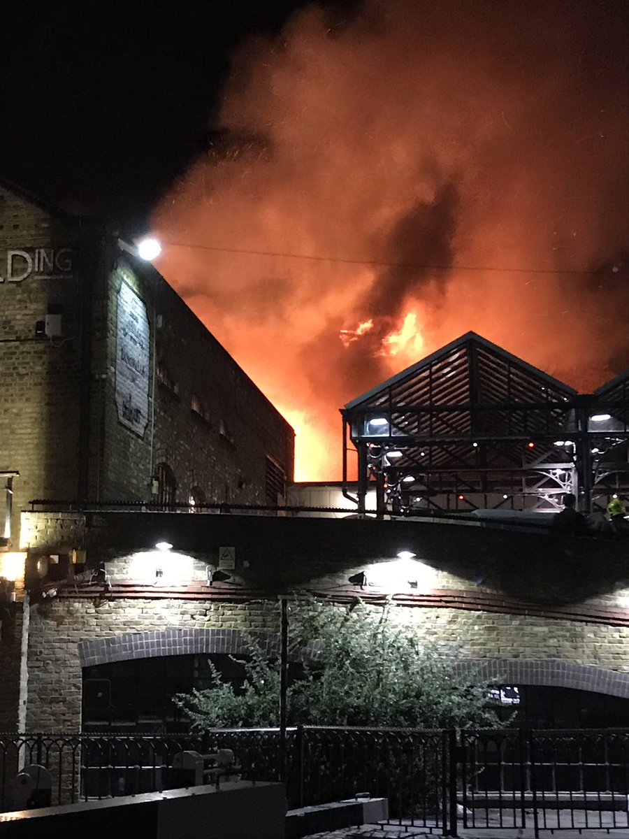 We now have ten fire engines and over 70 firefighters dealing with the #Camden Lock Market fire. Please avoid the area  © @CamdenJohnny