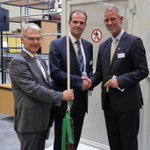 New logistics center at Diehl Laupheim boosting capacity for ramp up. Mayor handing over traditional Swabian broom at inaug. Clean deal.