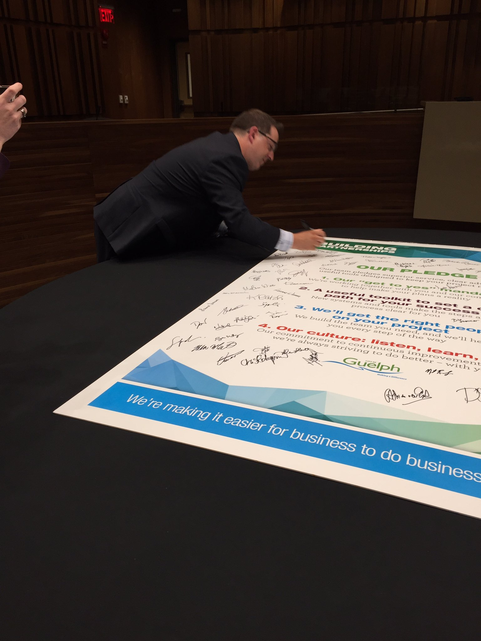 .@CamGuthrie is the first to sign the pledge rededicating the @cityofguelph to better business relations. https://t.co/jxa3qDhTmQ