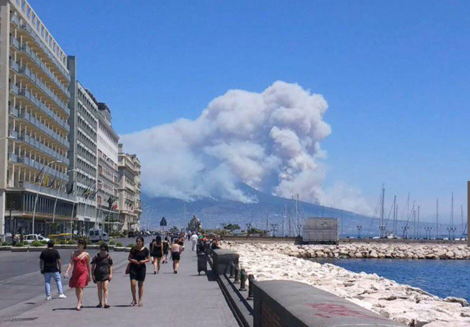 Vesuvius on fire this morning as well. Dramatic views. Large forest fires raging on its slopes.
