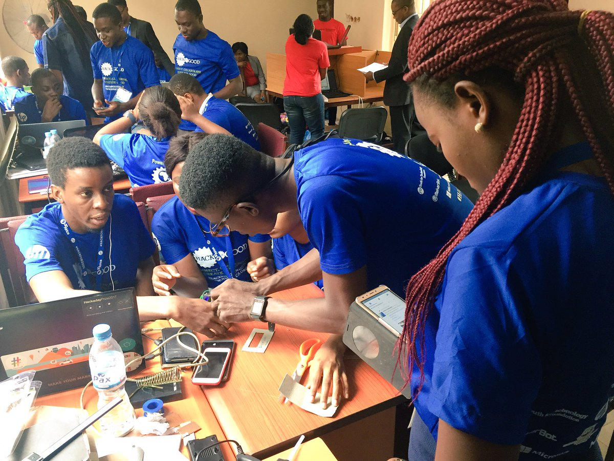 Members of Team Humanity developing their prototype –Green Lens.