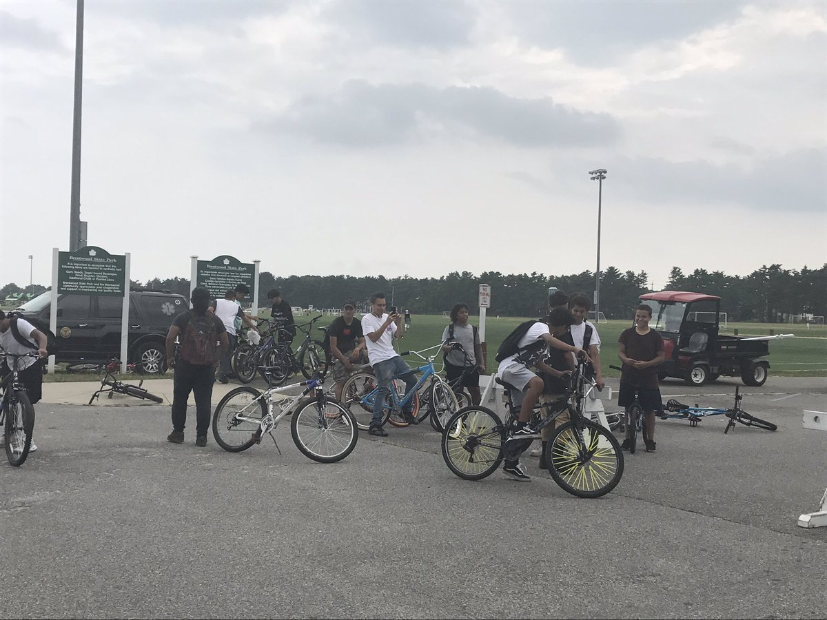 Local youth riding their bikes through Brentwood State Park stop and watch the protests outside @realDonaldTrump speech