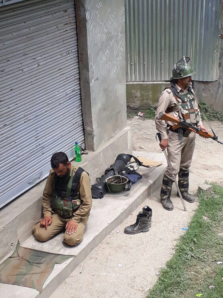 This is real India. A CRPF jawan stands guard while a J&K Police man offers Namaz in #Kashmir. Brothers in arms!