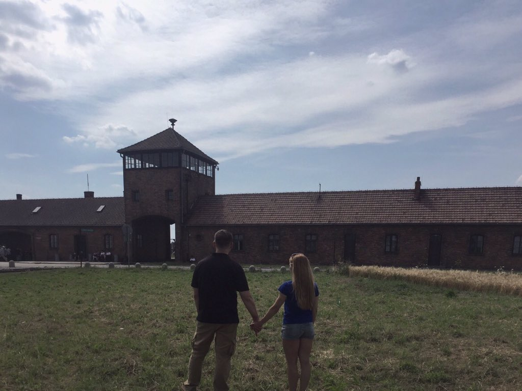 Jack Posobiec and girlfriend at Auschwitz, praying for the victims