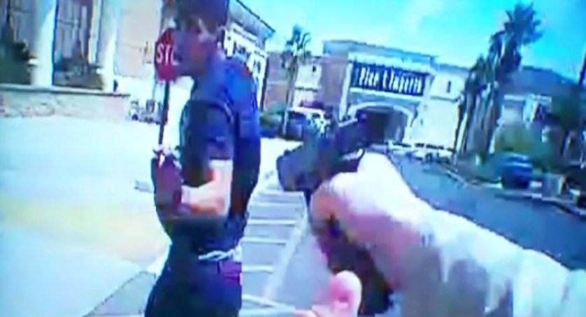 .@LVMPD shows body cam video of Officer Burr chasing suspect who is ignoring his commands. Suspect reaches for gun in waistband #8NN
