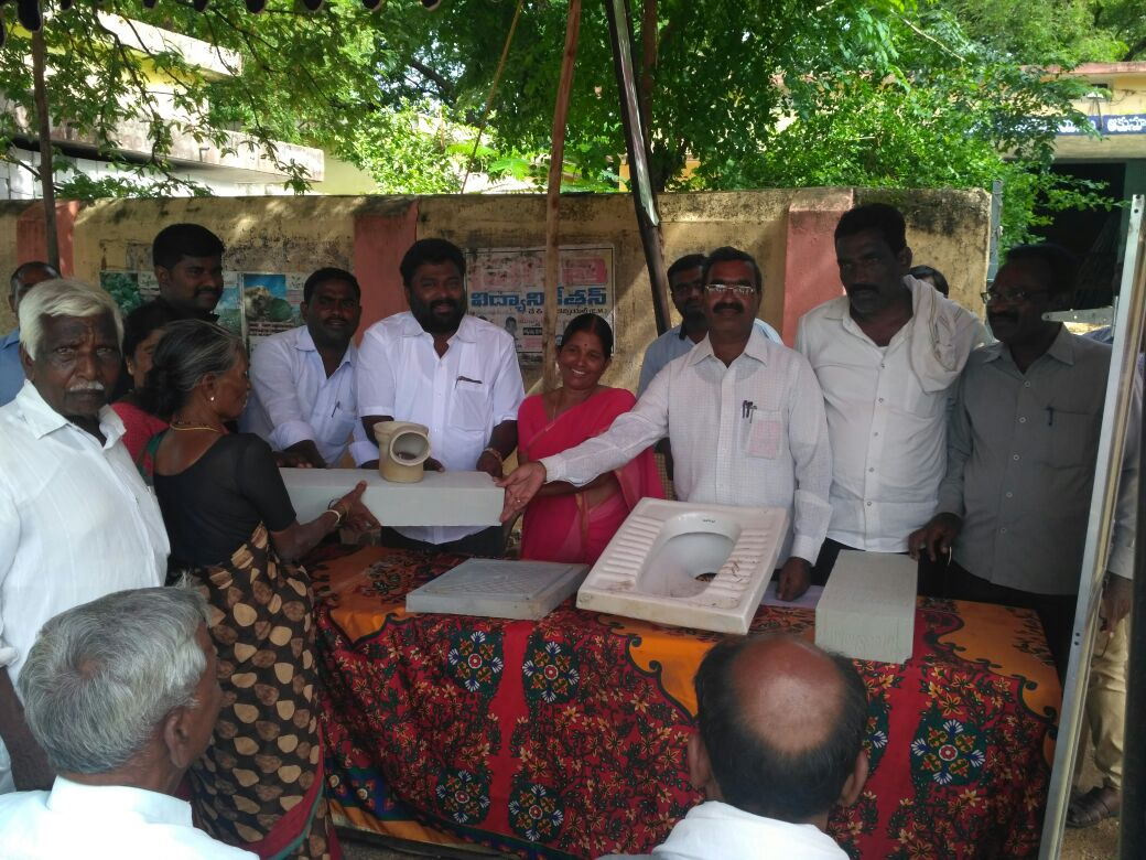 distribution of #Toilet sanitary materials in a public meeting cheryal mdl with festive mood, to accelerate @swachhbharat<br>http://pic.twitter.com/FJ8K5SzJpF