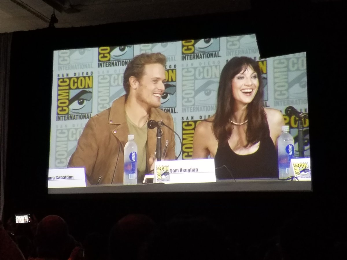 "Sam Heughan and Caitriona Balfe introduced at the SDCC ""Outlander"" panel. (Libby Hill / Los Angeles)"