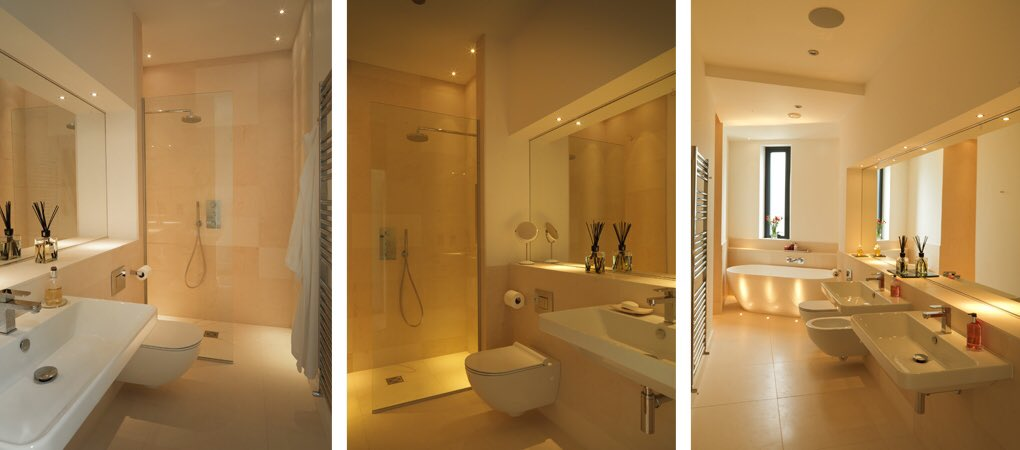 Clean lines with strong statement pieces softenend with neutral tiling. #Bespoke mirrors creating great depth #bathroomdesign #cheltenham<br>http://pic.twitter.com/xFs5zCBT4m