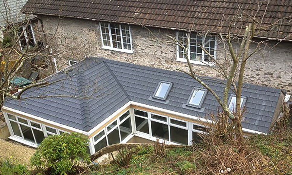 L-shaped conservatory roof using TapcoSlate Pewter Grey slates and ridge caps.  #roofing #Shake #slate <br>http://pic.twitter.com/HWHEfZJmzO