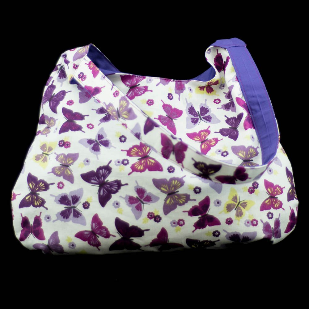 Gorgeous butterfly pattern handbag.Handmade by us here at Amelia&#39;s Grotto #handbag #butterfly #pattern #purple #handmade #ameliasgrotto<br>http://pic.twitter.com/598nxRGsuj