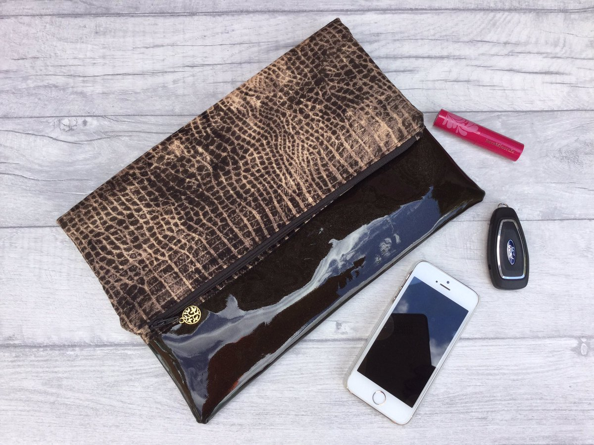 Now reduced to £15 cotton and glitter vinyl fold over clutch,  https://www. etsy.com/uk/listing/470 431415/sale-brown-cotton-and-glitter-vinyl?ref=shop_home_active_1 &nbsp; …  #HANDMADEHOUR #etsychaching #etsysheff<br>http://pic.twitter.com/xASzP1E3dc