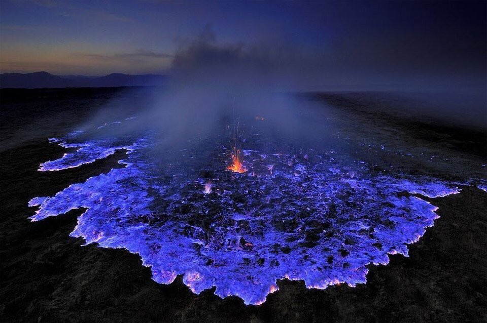Volcano Emits Glowing Blue Liquid, Indonesia   Photography by Olivier Grunewald <br>http://pic.twitter.com/wxPRxAyurg