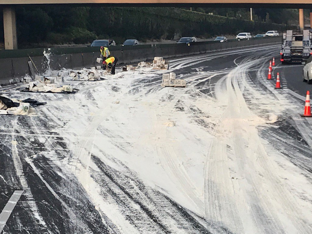 All lanes of I-5NB blocked near #Terwilliger. Drywall mud spill. What a mess. No eta to open #pdxtraffic https://t.co/uiaVtpLl7T