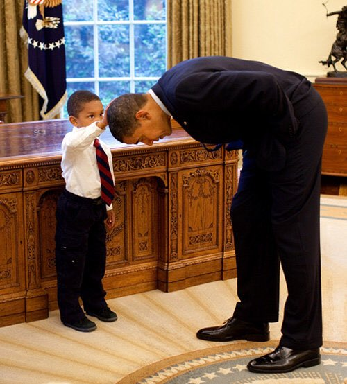 For me this remains the most profound picture ever taken of Obama. The little boy needed to know if Obama's hair was actually like his own.
