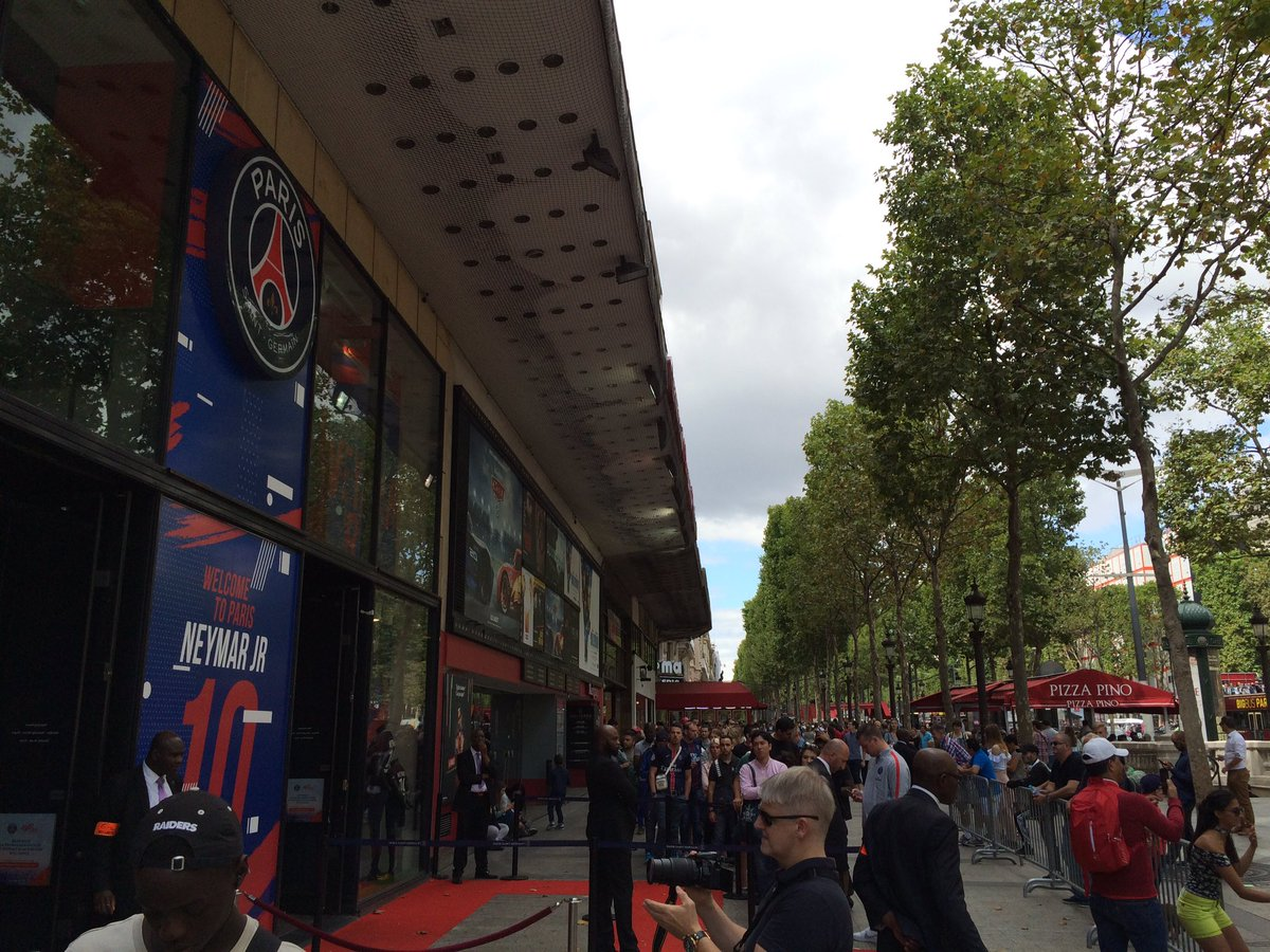 Queue to enter PSG store on Champs-Elysées stretches all the way down the block after Neymar's unveiling yesterday.