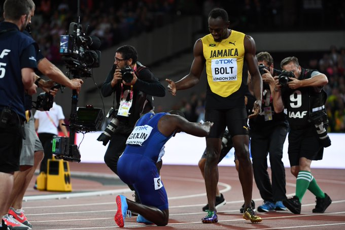 Image result for Justin Gatlin defeats Usain Bolt in the final solo race of his career and bows to him