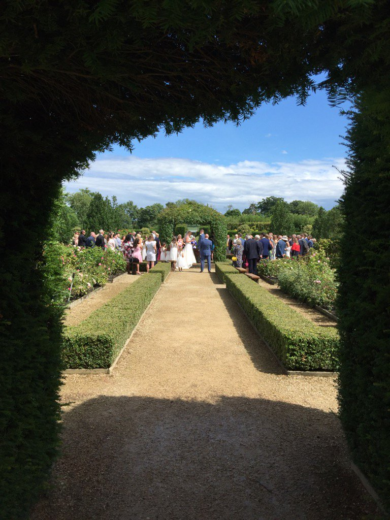 """""""Sunshine on a rainy day"""" yesterday! #wedding vows under the #rose arbour @LoseleyPark @Loseleyevents"""