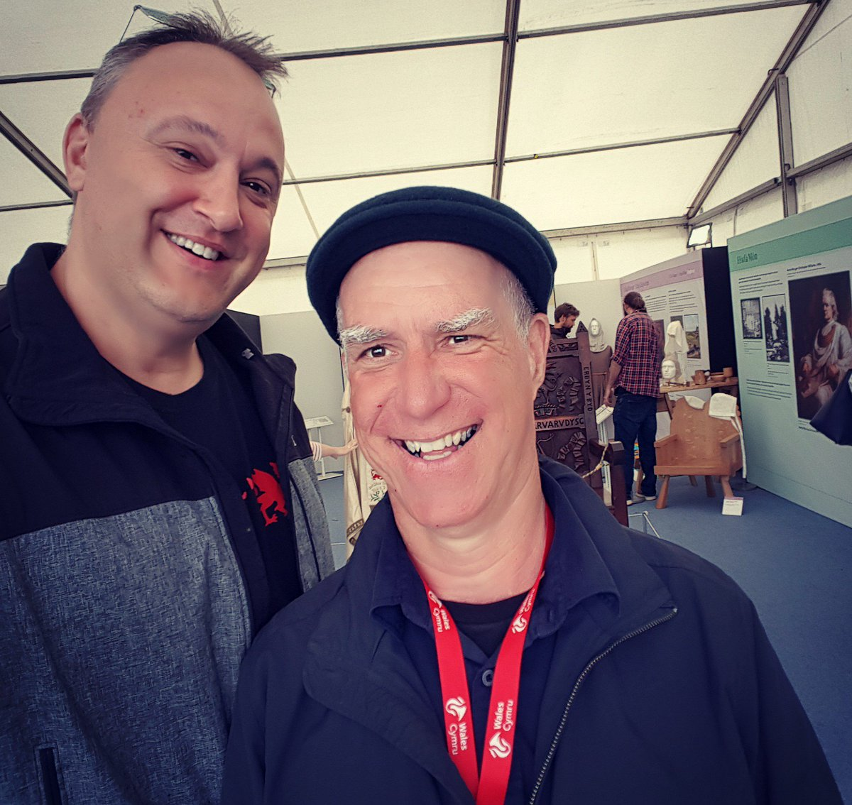Kristoffer with the coolest archaeologist known to mankind @therealrhysmwyn the History pavilion #Anglesey @eisteddfod just before the rain