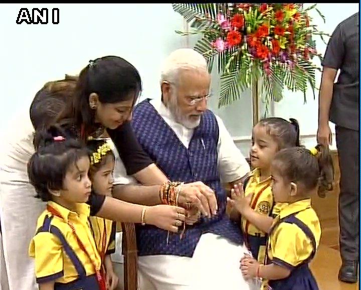 Delhi: Prime Minister Narendra Modi celebrated #RakshaBandhan with school children and Widows of Vrindavan in PMO