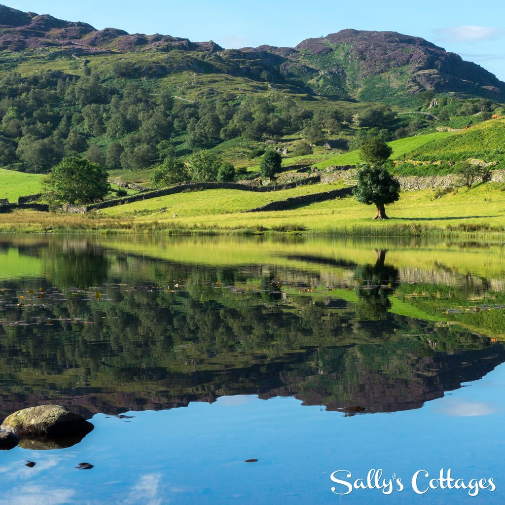 A little something to brighten up your #Wednesday - Stunning #reflections over Watendlath Tarn. #LakeDistrict #summer #peaceful<br>http://pic.twitter.com/IAYQ4TJdAZ