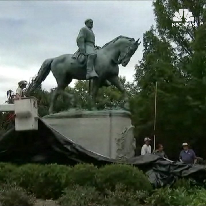 Workers have begun covering Robert E. Lee statue in Charlottesville with a black shroud.