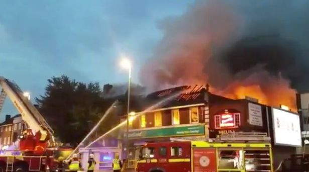 Firefighters battle 'suspicious' blaze at Poundland in London which engulfed flats above and caused roof to collapse https://t.co/tnQ30YIT2X