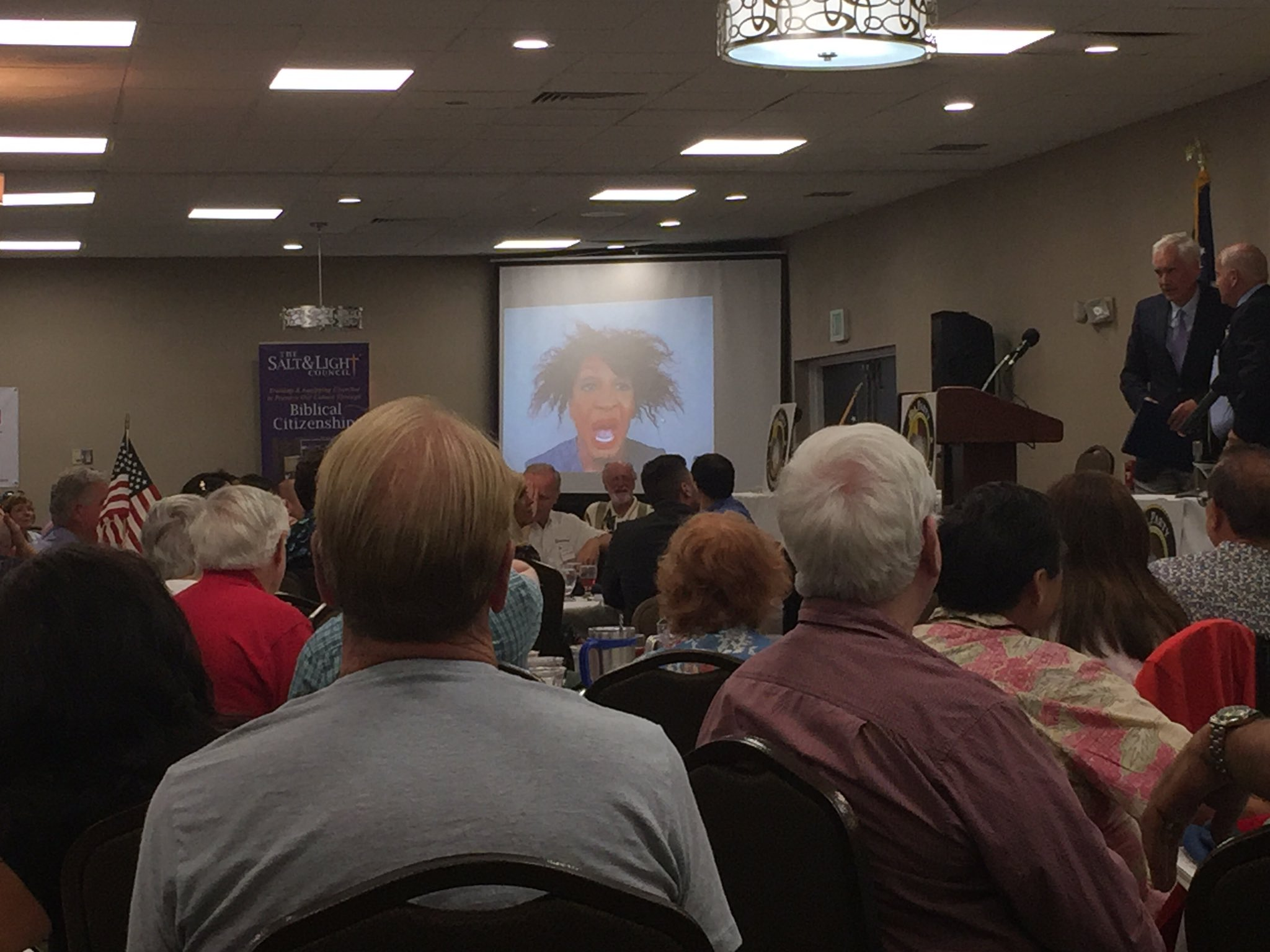 A doctored picture of Rep. Maxine Waters (D-Los Angeles) is put up on the screen at the Tea Party California Caucus meeting in Fresno. Tea partier Woody Woodrum said it was meant to be a joke. (Phil Willon / Los Angeles Times)