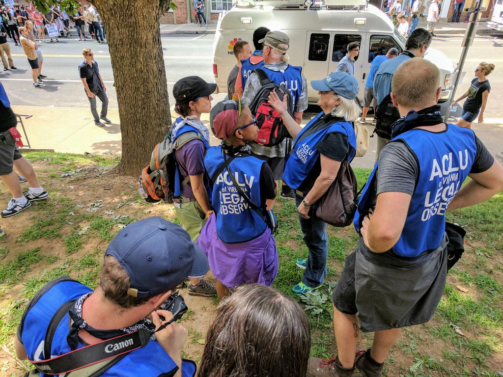 Our legal observers regroup to discuss what to do next. We will be here until the end. #Charlottesville
