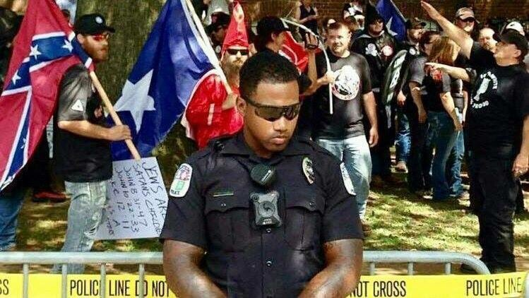 Out of all the pictures to come out of #Charlottesville we think this one speaks volumes.
