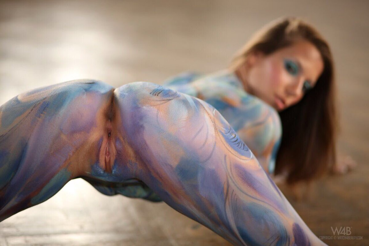 Three sexy girls in body paint eat out pussy