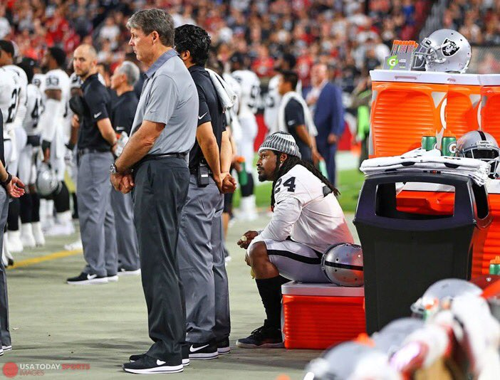 Marshawn Lynch sits during the national anthem prior to game against t...