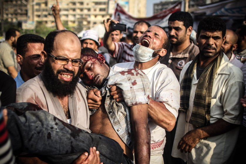 4yrs ago today, #Egypt security forces meticulously killed 1,000+ protesters in #Cairo's #Rabaa al-Adawiya Square.<br>http://pic.twitter.com/QHlXa2SUsc