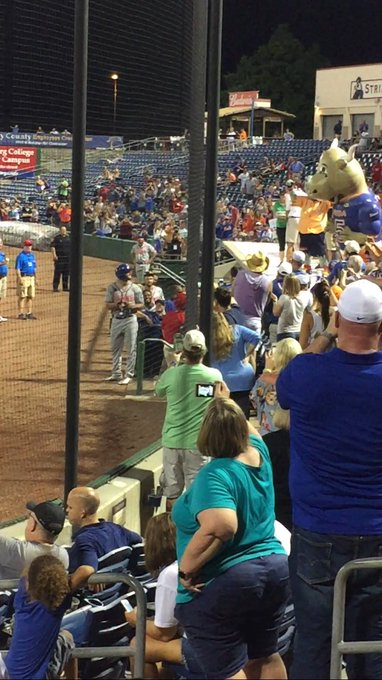 Tim Tebow eyes Tim Tebull after the crowd sings Happy Birthday to Tebow