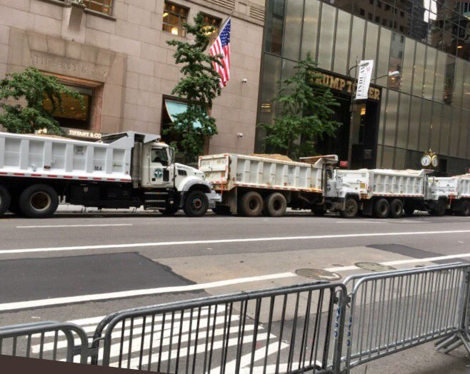 Prior to @POTUS NYC visit home tonight protestors surround Trump Tower which is being guarded by white trash trucks.