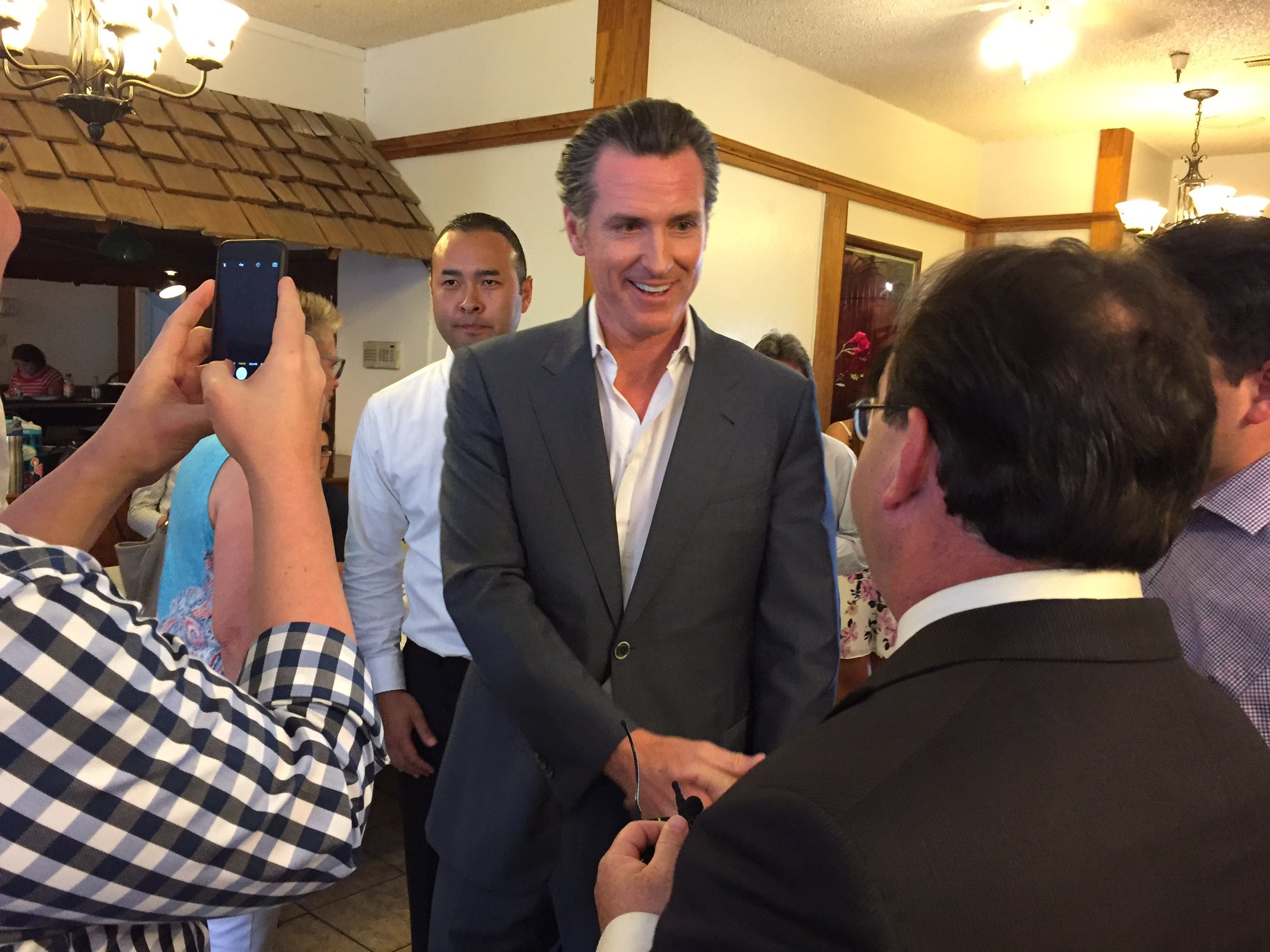 Lt. Gov. Gavin Newsom holds a meet-and-greet at Tuolumne Hall in Fresno on Tuesday as he campaigns for governor across the Central Valley. (Phil Willon / Los Angeles Times)