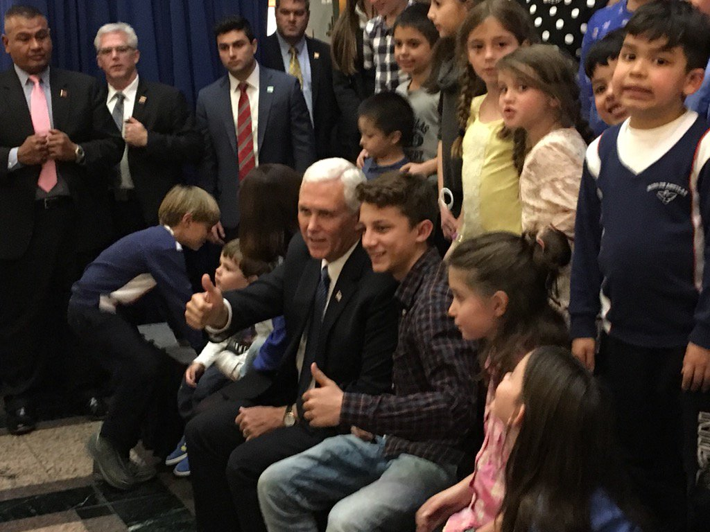 Vice President Mike Pence greeting kids whose parents work at the US embassy in Chile.