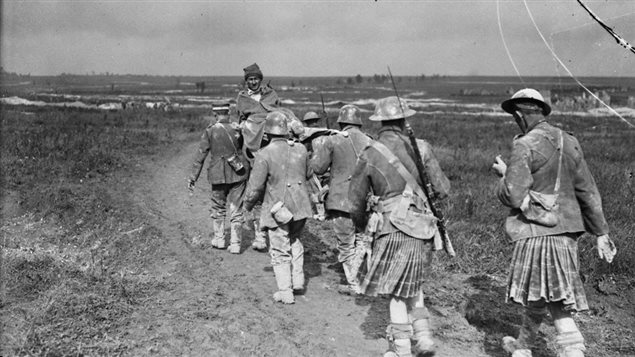 August 1917 - Wounded German prisoner, captured on Hill 70, being escorted to the rear by Canadian Highlanders #100yearsago