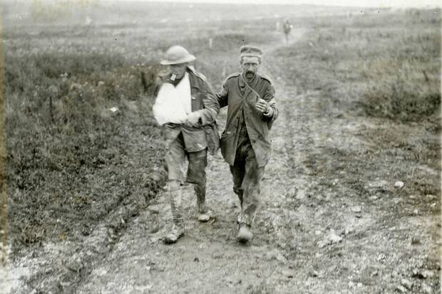 August 1917 - Wounded Canadian soldier and captured German prisoner walking to the rear, near Hill 70 at Lens, France #100yearsago