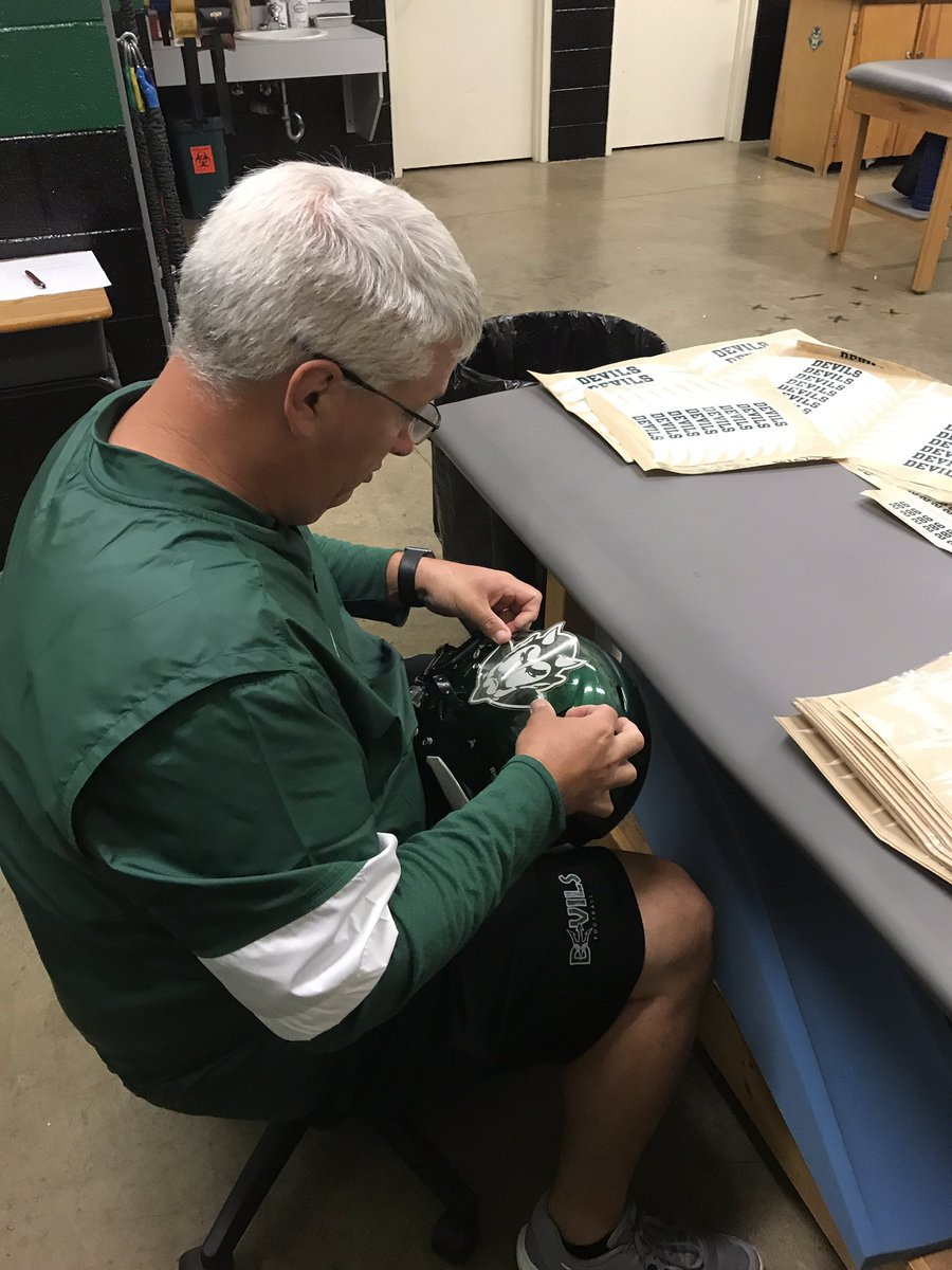You know it&#39;s getting close to game day when @evattatc is putting on helmet stickers!  #BestTrainerAround #DNC <br>http://pic.twitter.com/RgVdre8vpb