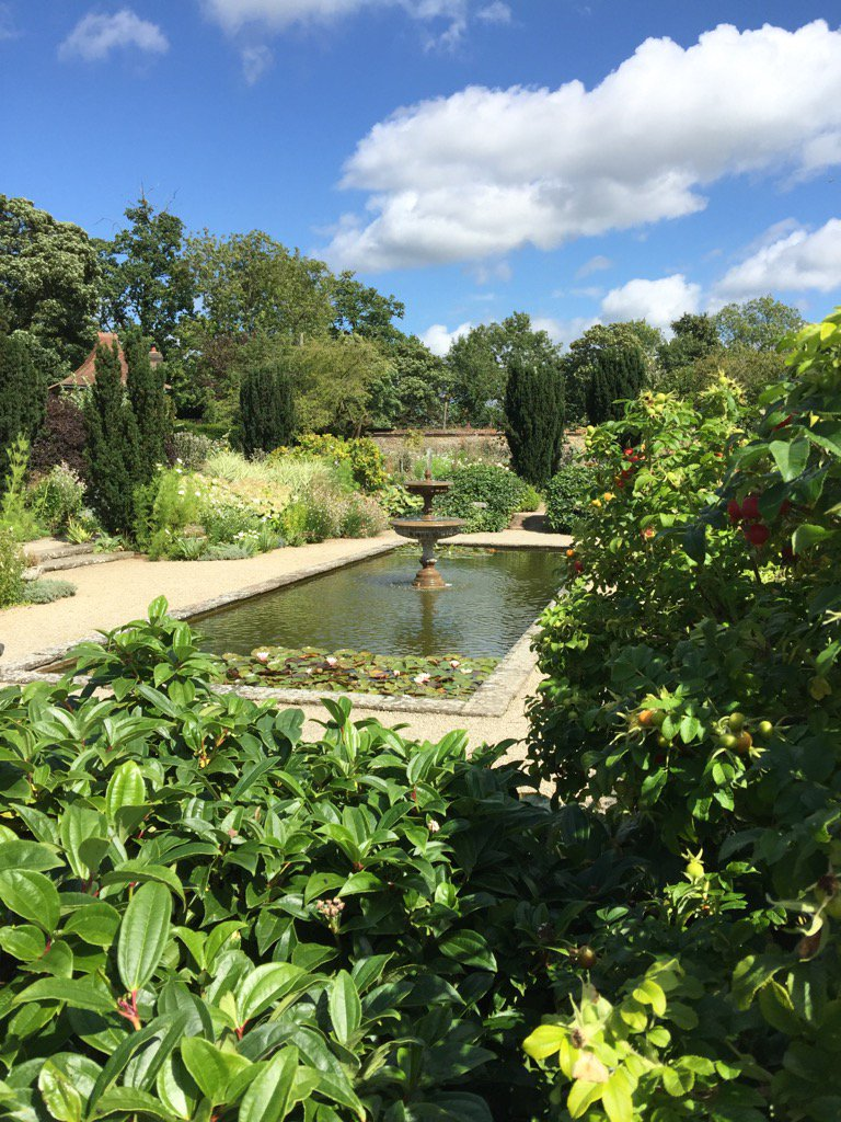 """""""Lazing on a sunny afternoon""""🎼 who wouldn't want to in a #garden like this? #walled garden #fountain"""
