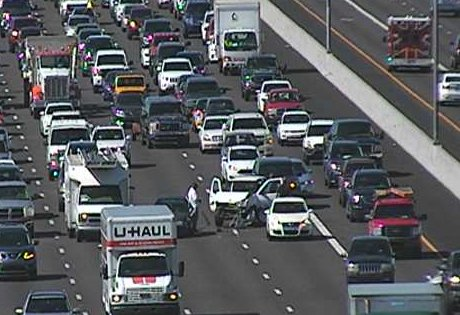 L-101 South at Chaparral, a crash is blocking the left two lanes. HOV lane is open.
