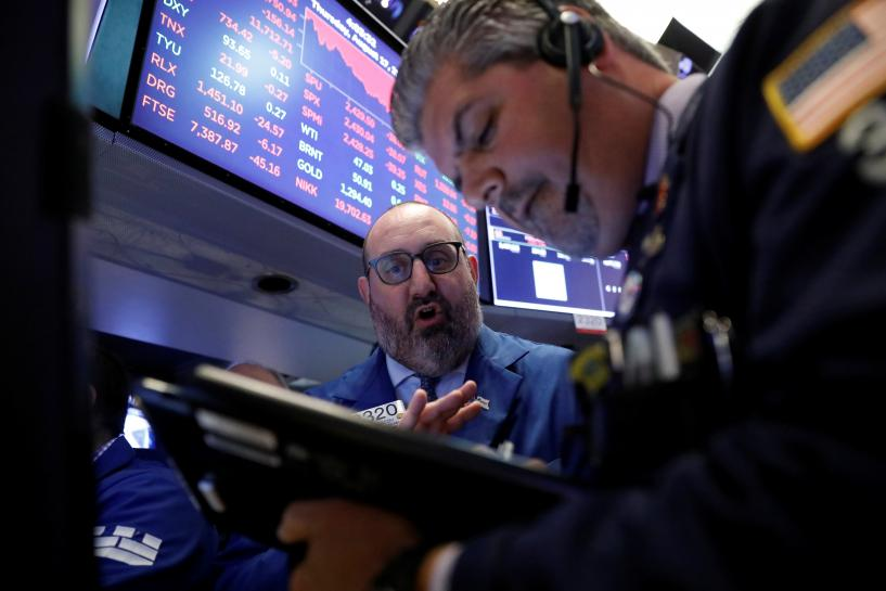 Wall Street pares losses on report of Ba...