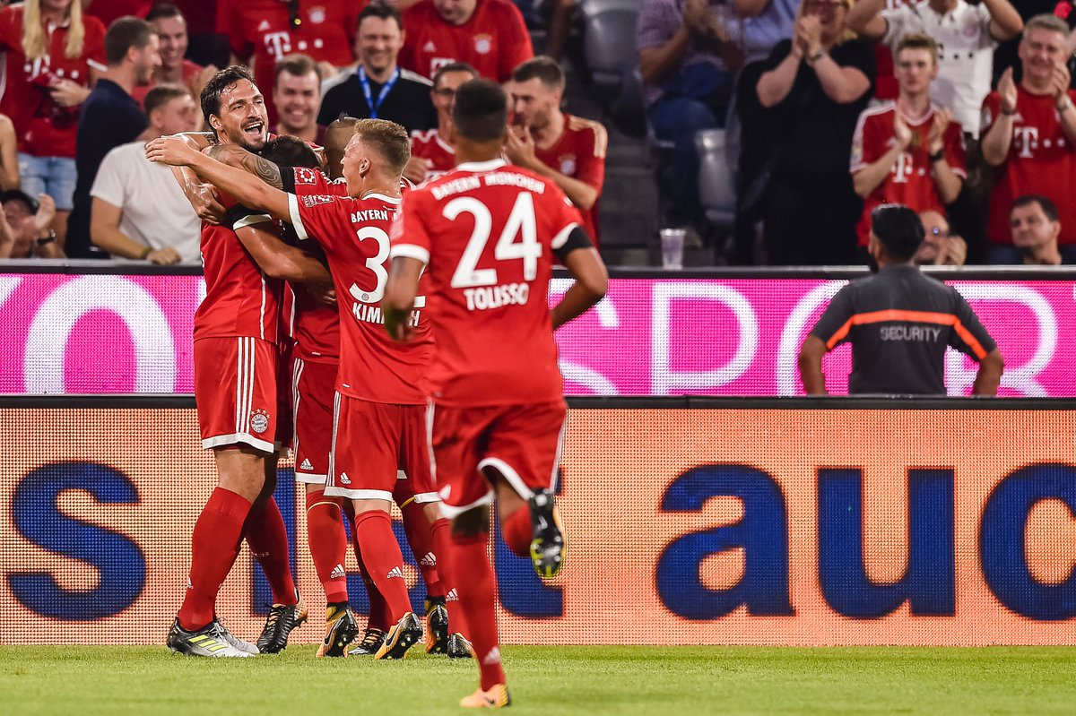 Bayern Munich players rush to celebrate with Niklas Sule after he open...
