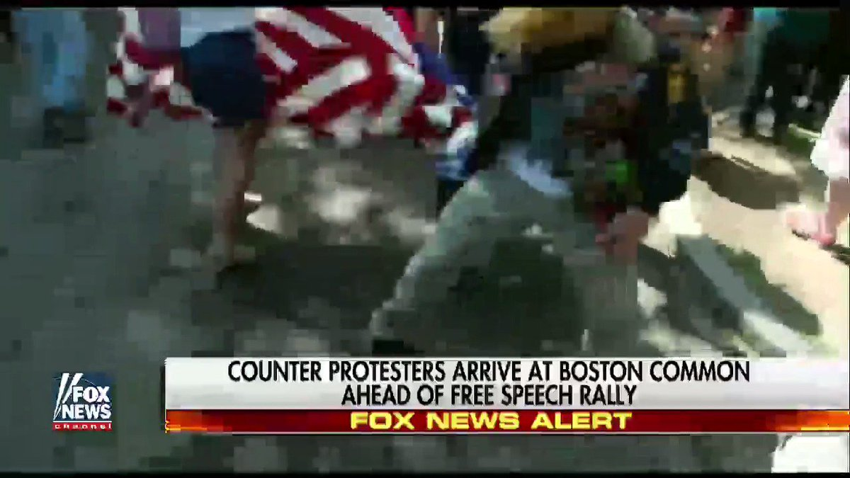 MOMENTS AGO: Woman waving American flag hit, dragged by counter-protes...